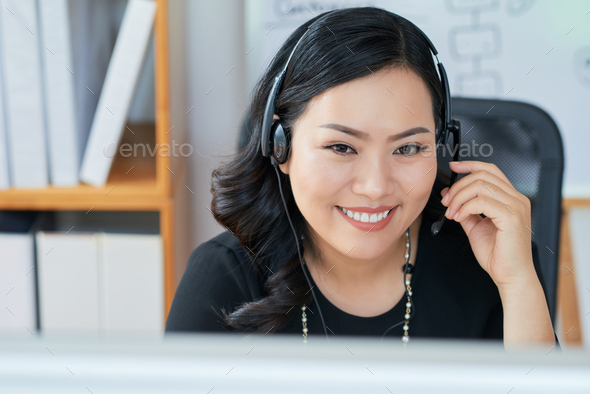 Business lady wearing headset - Stock Photo - Images