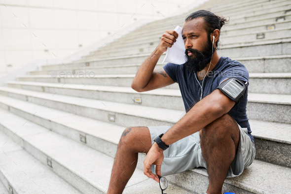 Tired Runner After Workout - Stock Photo - Images