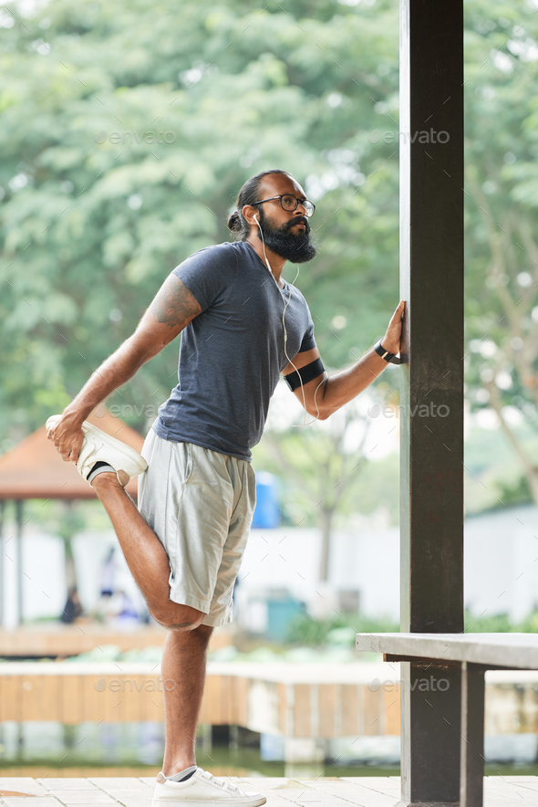 Male Runner Warming Up - Stock Photo - Images