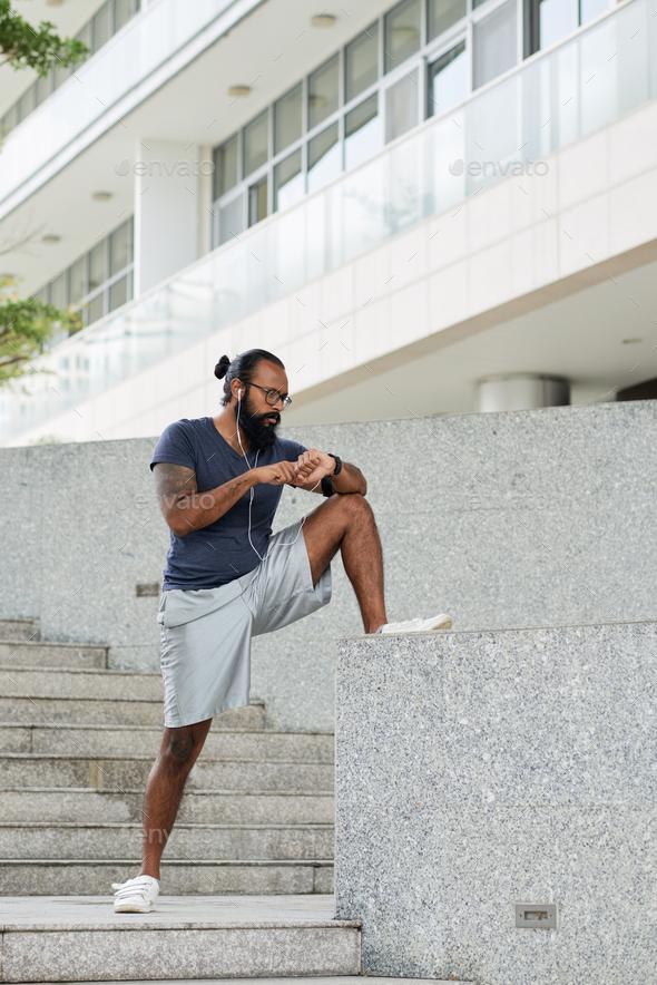 Bearded Athlete Warming Up - Stock Photo - Images