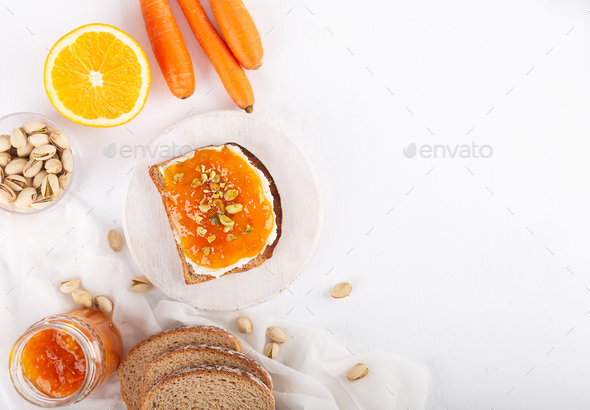 Carrot Jam with orange juice on a gray background - Stock Photo - Images