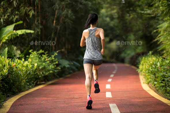 Fitness woman morning exercise in park - Stock Photo - Images