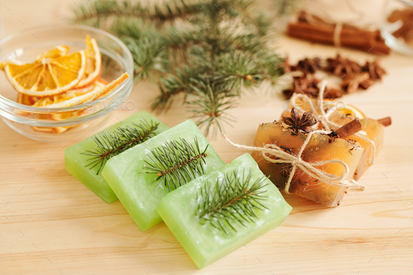 Fresh handmade soap bars scented by conifer and aromatic spices on table - Stock Photo - Images