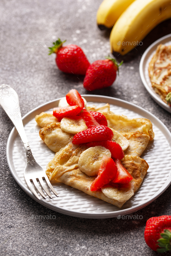 Crepes with strawberry and banana - Stock Photo - Images