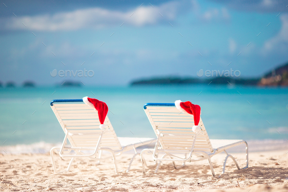 Closeup santa hat on chair on tropical white beach - Stock Photo - Images