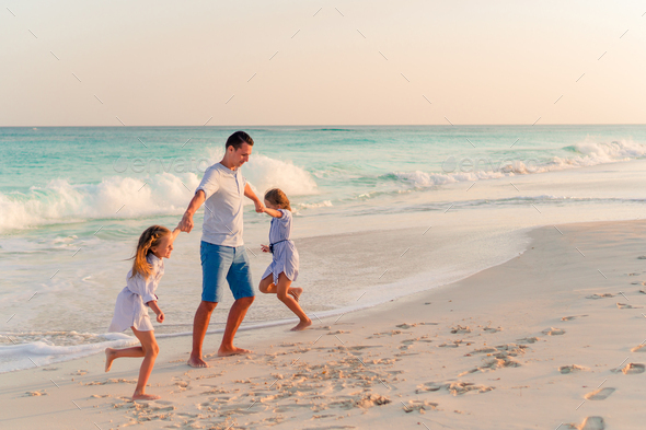 Family walking on white tropical beach on caribbean island - Stock Photo - Images