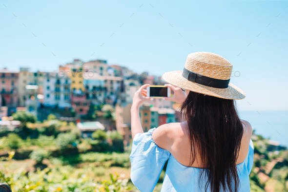 Tourist looking at scenic view of Vernazza, Cinque Terre, Liguria, Italy - Stock Photo - Images