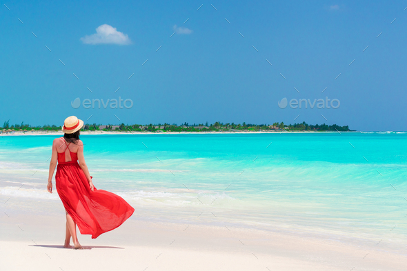 Young girl in beautiful red dress background the sea - Stock Photo - Images