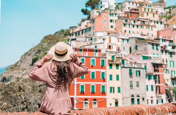 Young woman with great view at old village Riomaggiore, Cinque Terre, Liguria - Stock Photo - Images