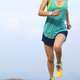 Successful woman runner running to mountain top - PhotoDune Item for Sale