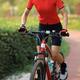 Woman biker riding bike in park - PhotoDune Item for Sale