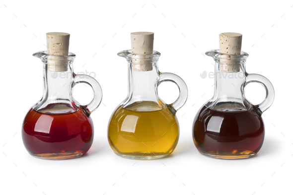 Glass bottles with different types of cooking oil - Stock Photo - Images