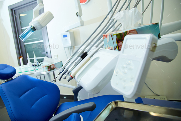 Modern metallic dentist tools and burnishers on a dentist chair - Stock Photo - Images