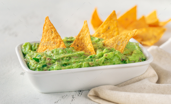 Bowl of guacamole with tortilla chips - Stock Photo - Images