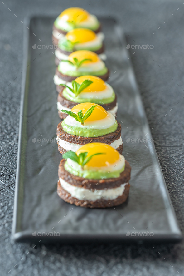Canape with fried quail eggs - Stock Photo - Images