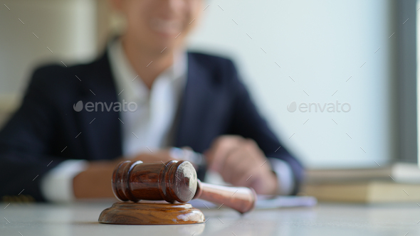 Concept of justice, Hammer and the lawyer are giving legal advice. - Stock Photo - Images