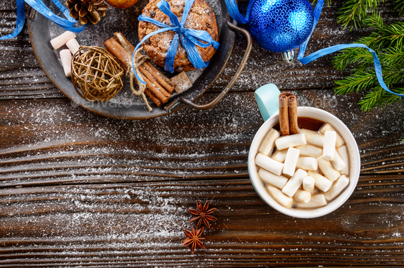 Flat lay Christmas background of blue mug with hot chocolate and - Stock Photo - Images