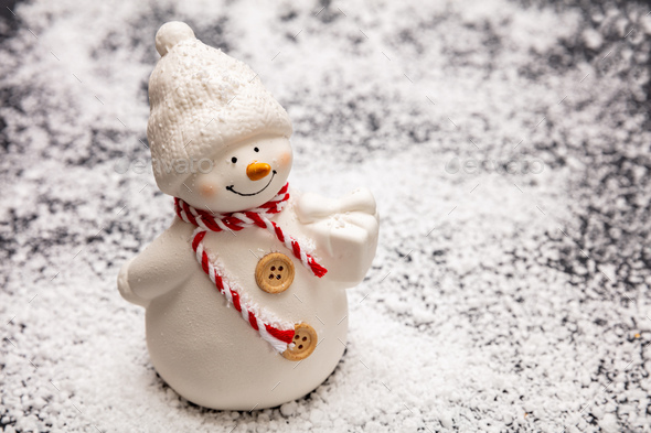 Snowman on snowy background, copy space - Stock Photo - Images