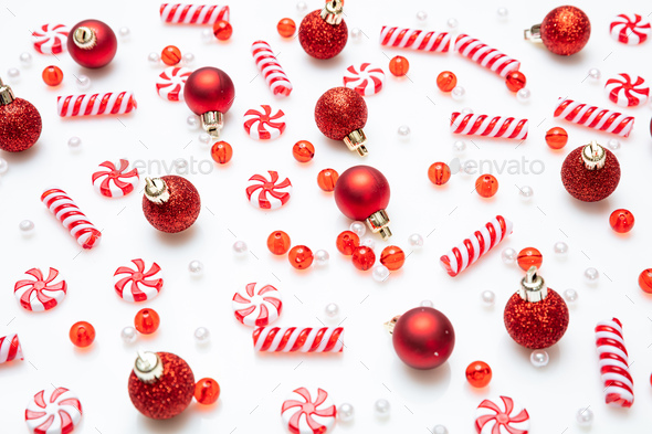 Xmas baubles and candies flat lay against white background - Stock Photo - Images
