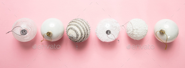 Xmas baubles white color against pink background, high angle - Stock Photo - Images
