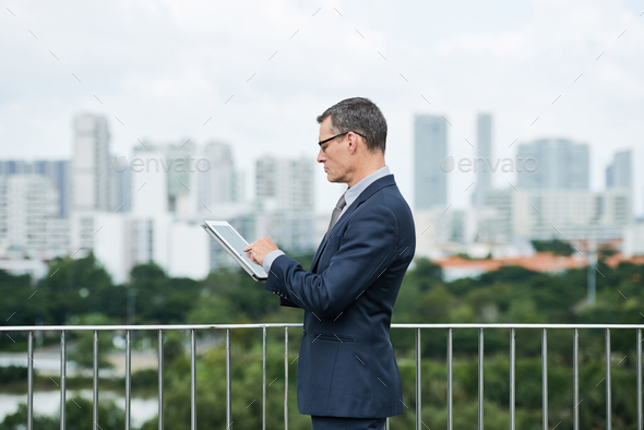 Entrepreneur checking e-mails - Stock Photo - Images