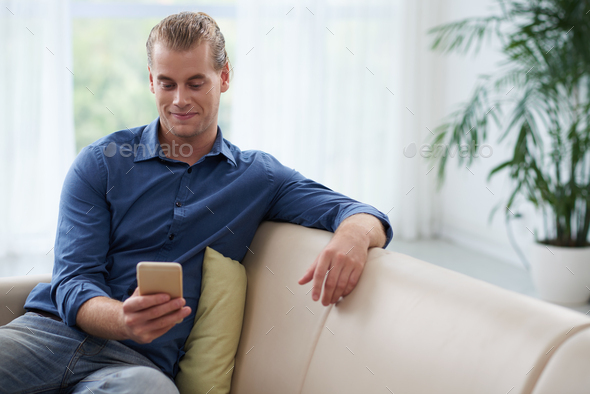 Texting man - Stock Photo - Images