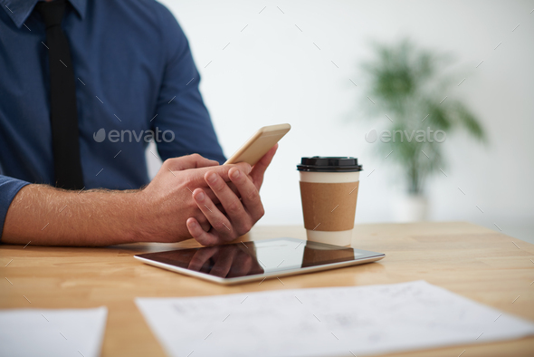 Businessman at office table - Stock Photo - Images