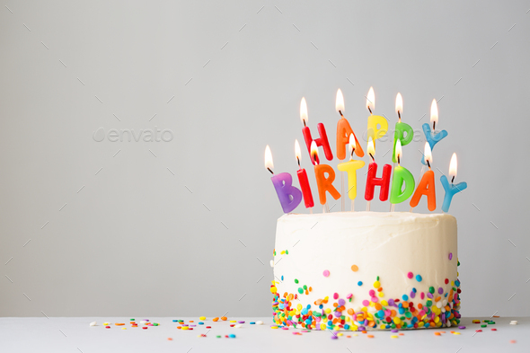 Birthday cake with colorful candles - Stock Photo - Images