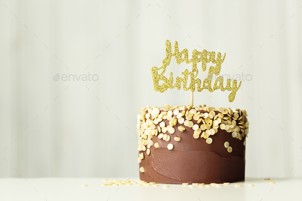 Chocolate and gold birthday cake - Stock Photo - Images