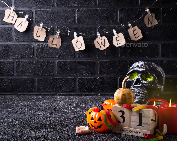 Halloween background with skull and candles - Stock Photo - Images