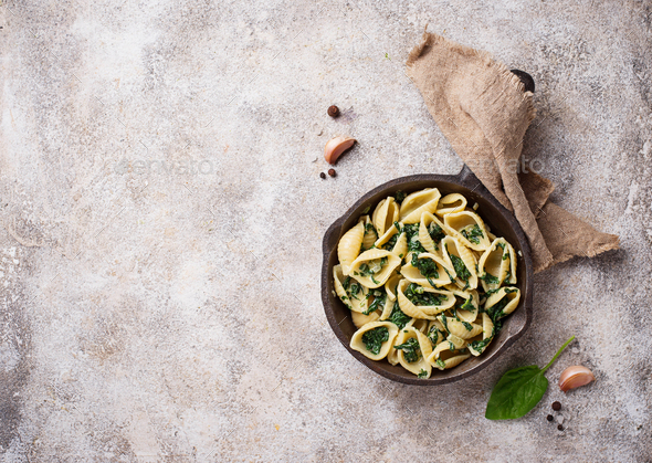 Conchiglioni pasta with spinach in creamy sauce - Stock Photo - Images
