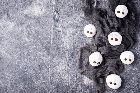 Meringue in shape of ghost - Stock Photo - Images