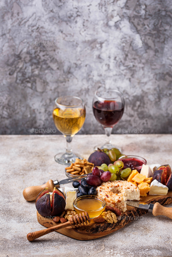 Cheese plate with grapes and wine - Stock Photo - Images
