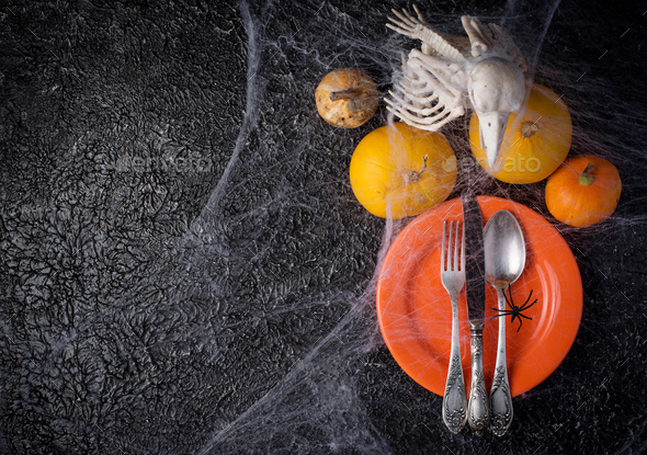 Halloween table setting with plate and web - Stock Photo - Images