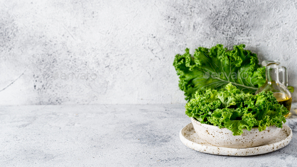 Kale leaves in bowl, copy space left - Stock Photo - Images