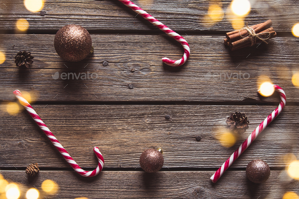 Christmas composition isolated on white. Striped straws, glass balls and ribbon. New Year flat lay - Stock Photo - Images
