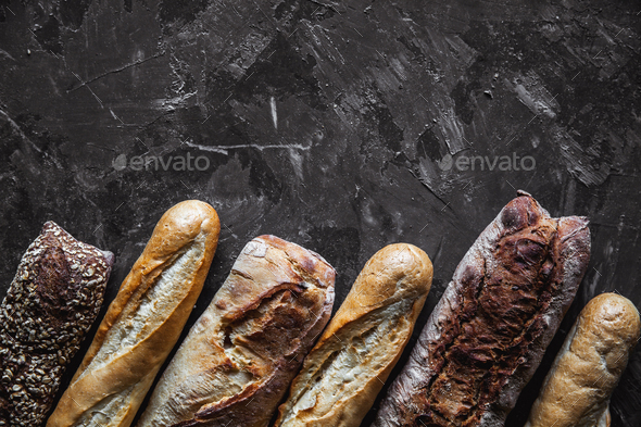 Baguette mix on a black background. French pastries, homemade - Stock Photo - Images