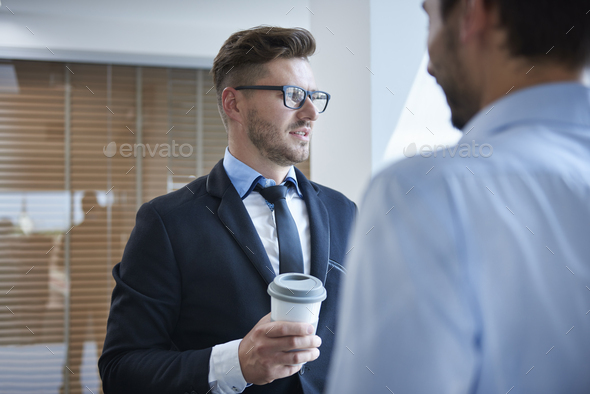 Men talking over a cup of coffee - Stock Photo - Images