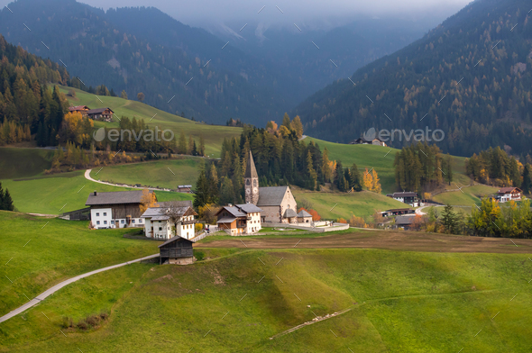 Green alpine valley with view of Santa Maddalena village church, - Stock Photo - Images