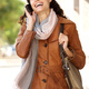 young woman smiling and talking on cellphone in the city - PhotoDune Item for Sale