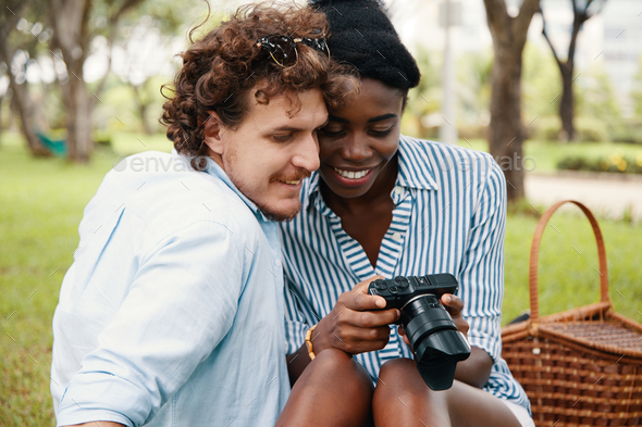 Couple checking camera - Stock Photo - Images
