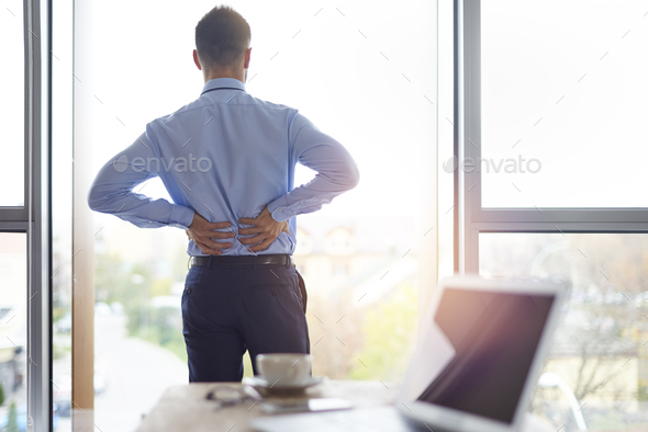 Back pain of business person - Stock Photo - Images