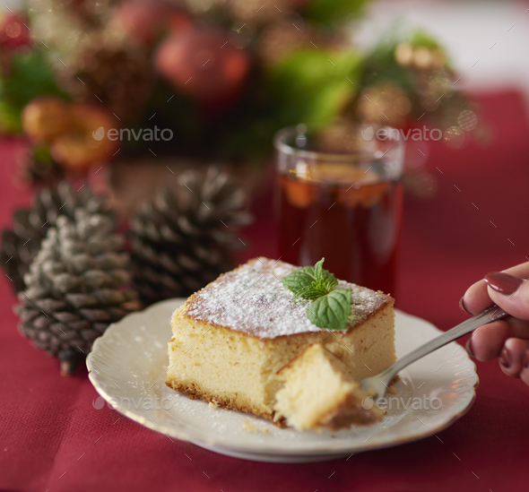 Cutting a piece of traditional cheesecake - Stock Photo - Images