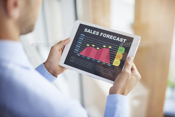 Sales forecast on digital tablet - Stock Photo - Images