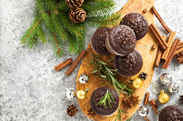 Christmas chocolate muffins. Xmas or New Year festive baking with decorations and fir tree - Stock Photo - Images