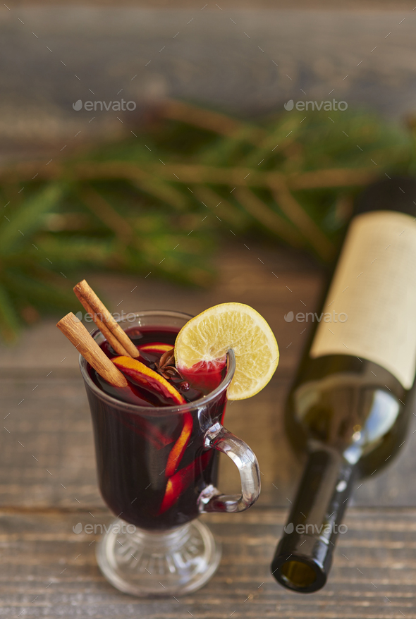 Warming up by having glass of mulled wine - Stock Photo - Images