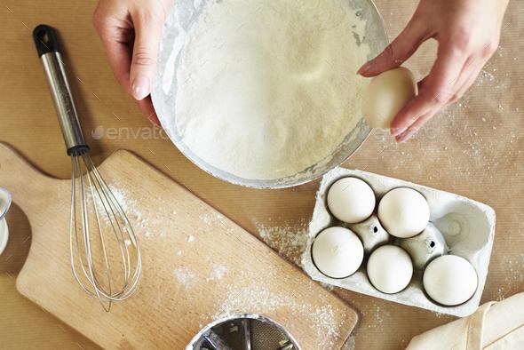 Breaking egg on the edge - Stock Photo - Images