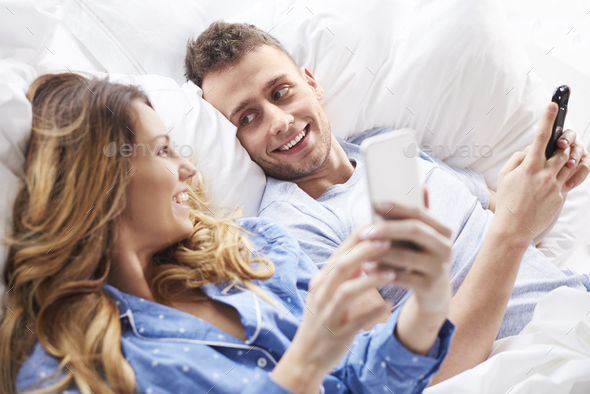 Couple with mobile phones holding in hands - Stock Photo - Images