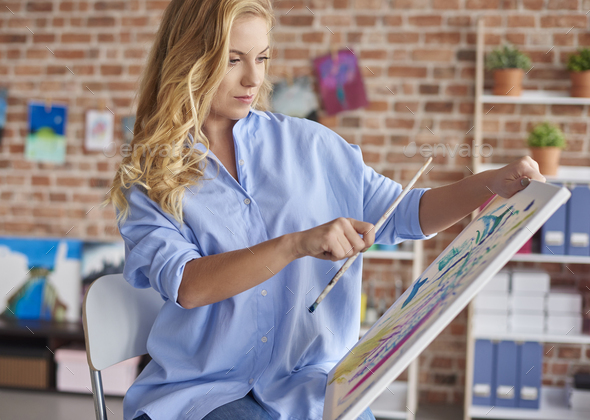 Taking measures while painting a picture - Stock Photo - Images