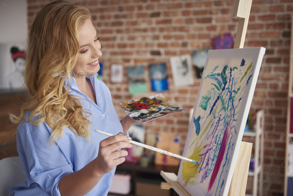 Creative woman working in her workshop - Stock Photo - Images